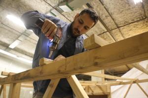 George assembles the Sauna tent framework